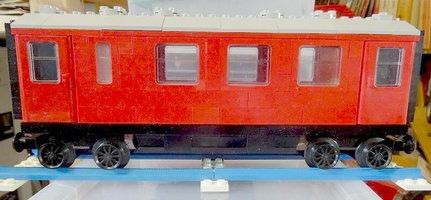 Набор LEGO MOC-12895 Passenger car 4x red with toilet
